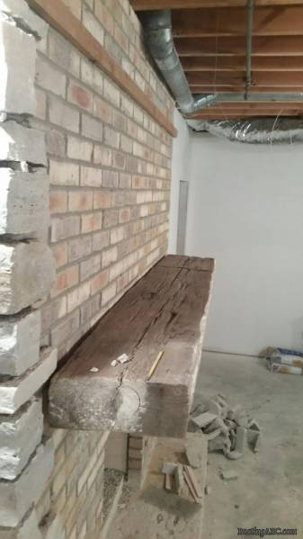 during_fireplace_mantle_barn_beam
